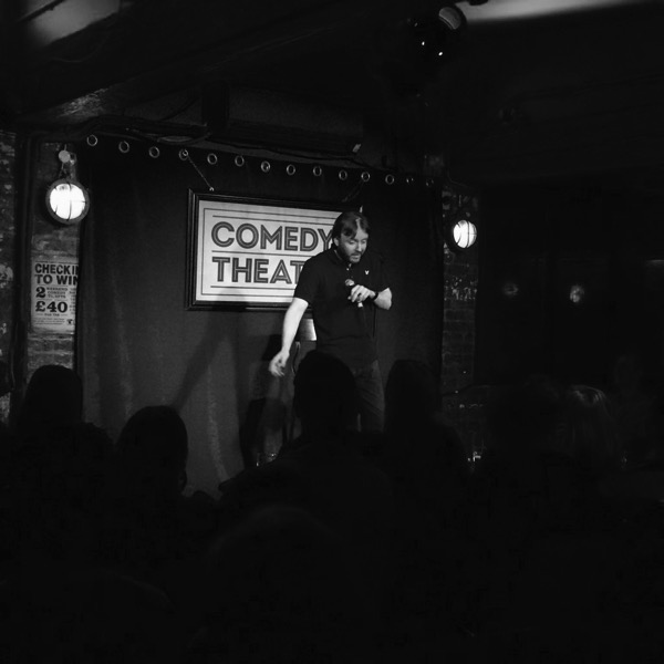Chris McCausland on stage at Londons Comedy Cafe Theatre